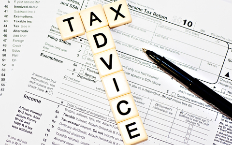 Tax Advice spelled in tiles over tax document